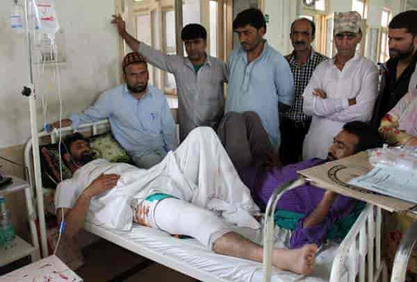 One of the injured, Mohammad Amin, from Ramban at a Srinagar hospital. Photograph by Shahid Tantray
