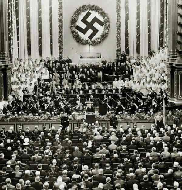 The Berlin Philharmonic Orchestra performs for a Nazi gathering.