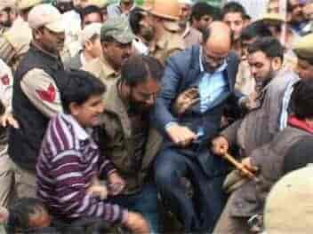 Nasir Aslam Wani kicking a worker