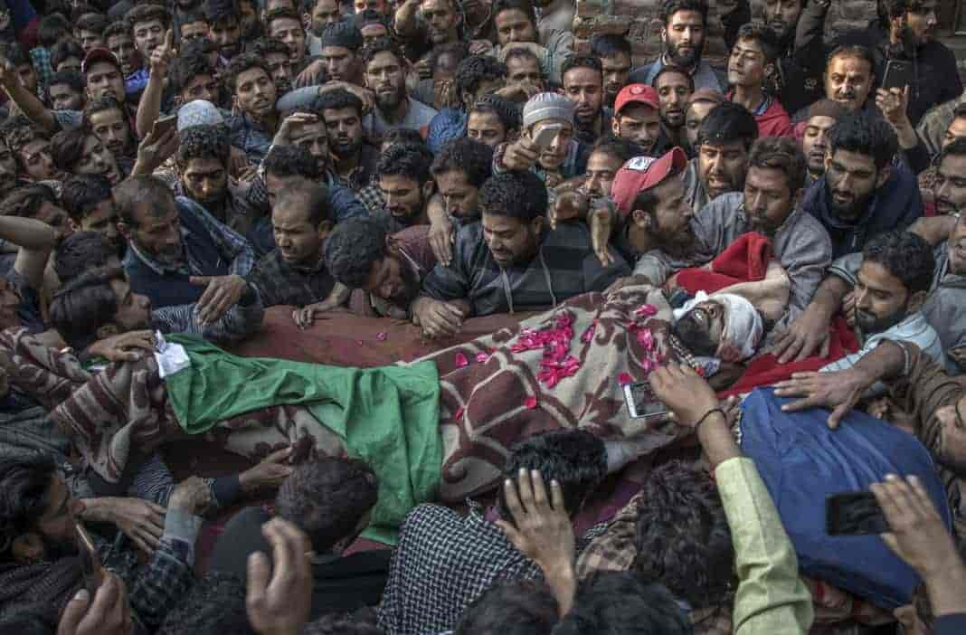 Bilal Ahmad Ganie's body being carried to the nearby ground for funeral procession on Monday morning. Photograph by Vikar Syed